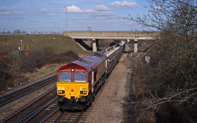 66079 up STVA empties, Didcot North Junction, 23-2-99.