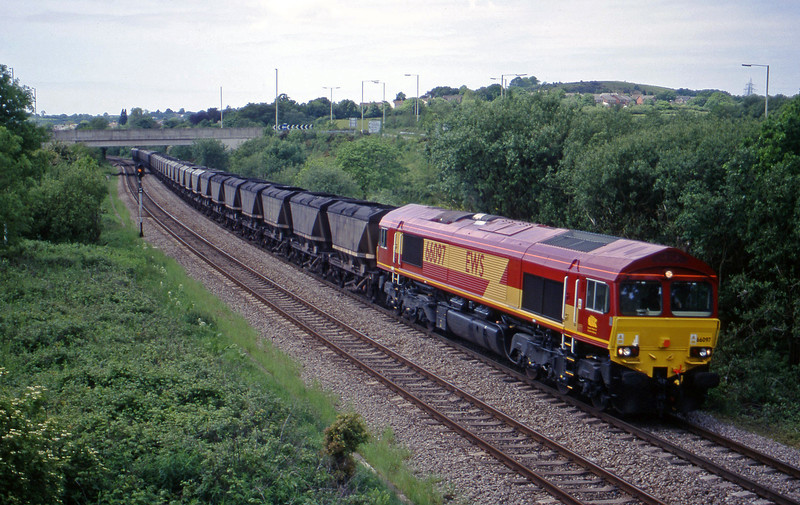66097, 12.15 Grange Sidings-Llanwern, Brynna, near Bridgend, 25-5-99.