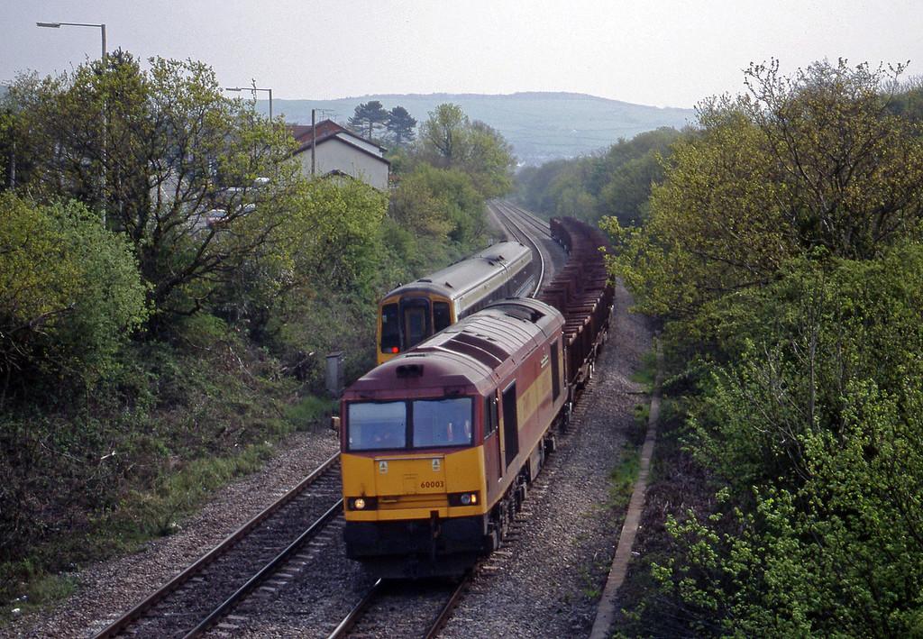 60003, down steel empties, Brynna, near Bridgend, 4-5-99.
