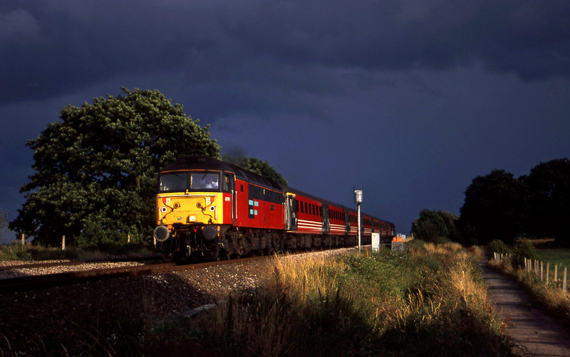 47741, up ecs, tailed by 47839, Powderham, near Exeter, 28-7-00.