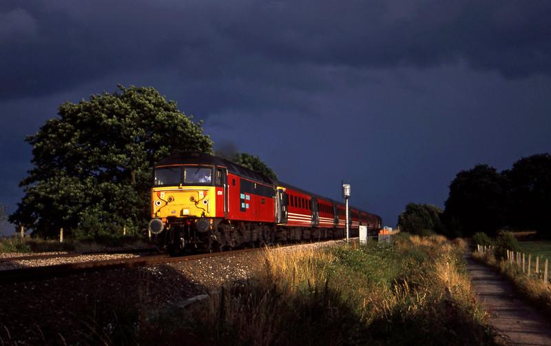 47741, up ecs, tailed by 47839, Powderham, near Exeter, 28-7-00.