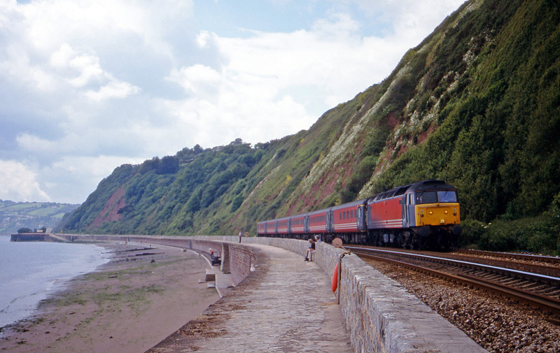 47827, 11.50 Plymouth-Liverpool Lime Street, Holcombe, near Teignmouth, 5-6-00.
