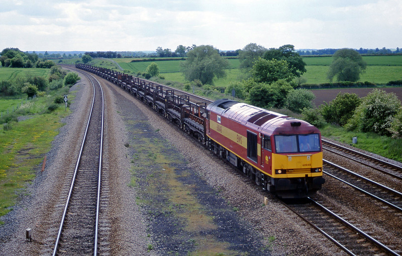 60048, down steel empties, Bolton Percy, near York, 30-5-00.