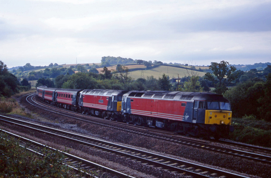 47829/47828, 08.46 Penzance-Manchester Piccadilly, Aller Divergence, near Newton Abbot, 18-9-01.