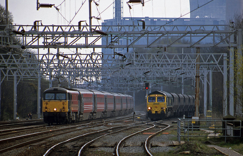 87010, 10.55 London Euston-Manchester Piccadilly, 66523, down mgr empties, from Rugeley Power Station, Rugeley Trent Valley, 10-4-02.