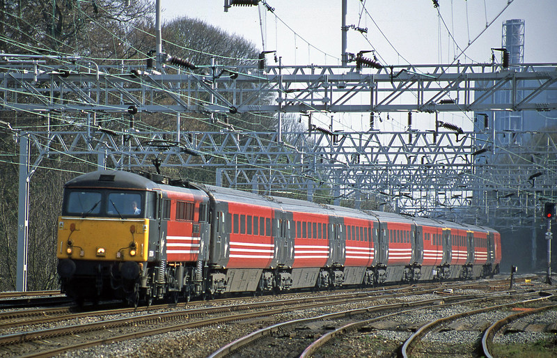 87014, 13.55 London Euston-Manchester Piccadilly, Rugeley Trent Valley, 10-4-02.