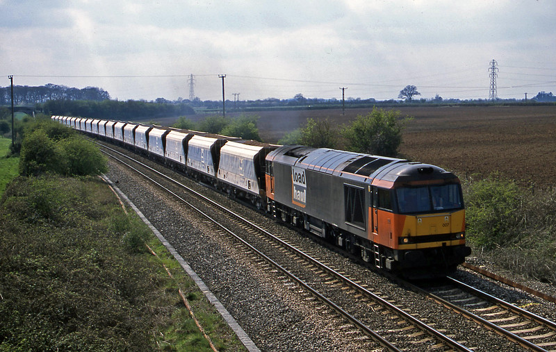 60007, 12.45 Merehead Quarry-Eastleigh, Berkley Marsh, near Frome, 16-4-02.