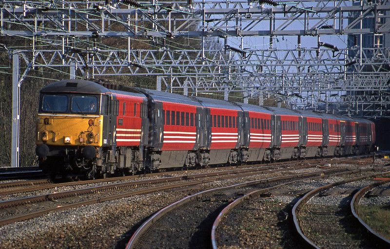 87030, 15.57 London Euston-Manchester Piccadilly, Rugeley Trent Valley, 10-4-02.