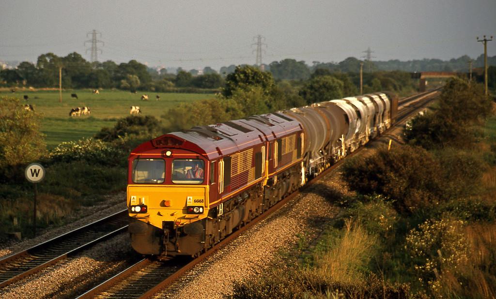 66168/66019, 16.55 St Blazey-Cliffe Vale, Exminster, near Exeter, 6-8-02.