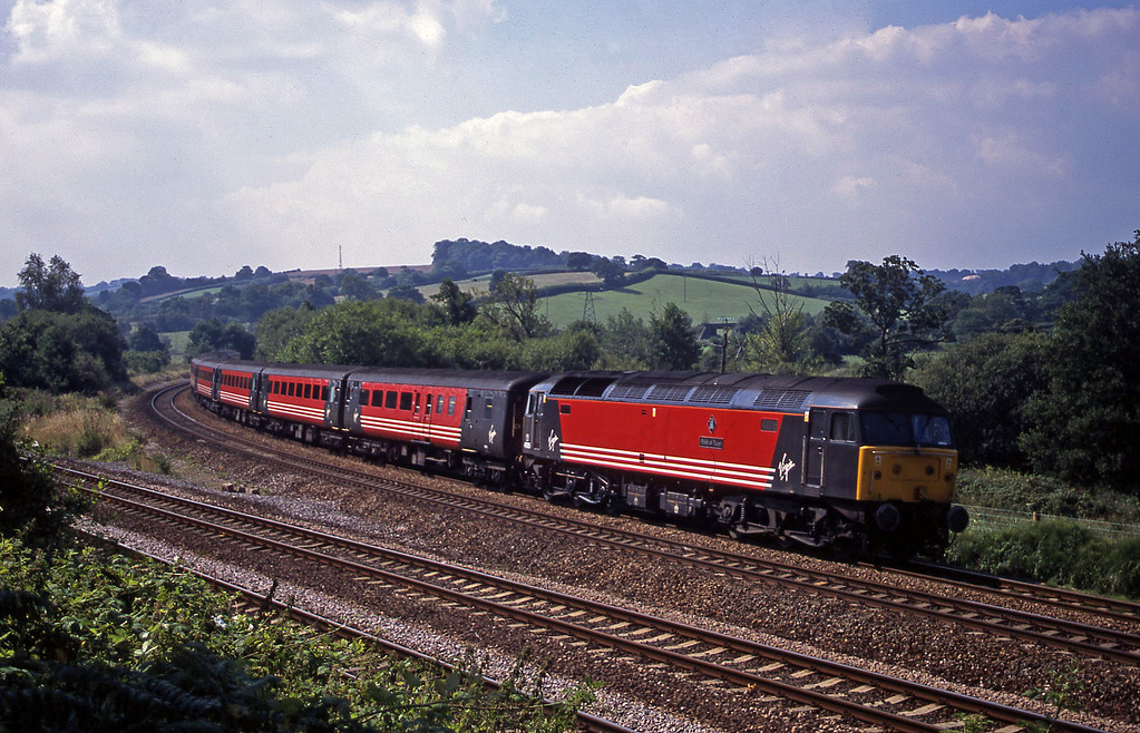 47805, 08.46 Penzance-Manchester Piccadilly, Aller Divergence, near Newton Abbot, 6-8-02.