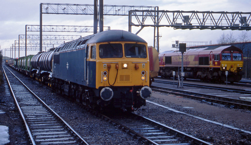 56006 parked on mixed freight, Avonmouth Bulk Handling Terminal, 22-1-02. 66246 parked.