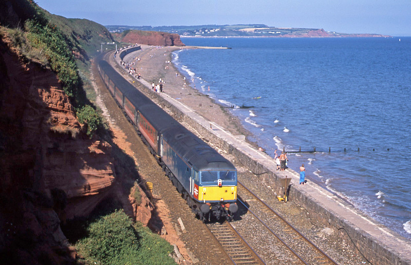 47839/47853, 15.50 Plymouth-Manchester Piccadilly, Dawlish, 28-7-02.