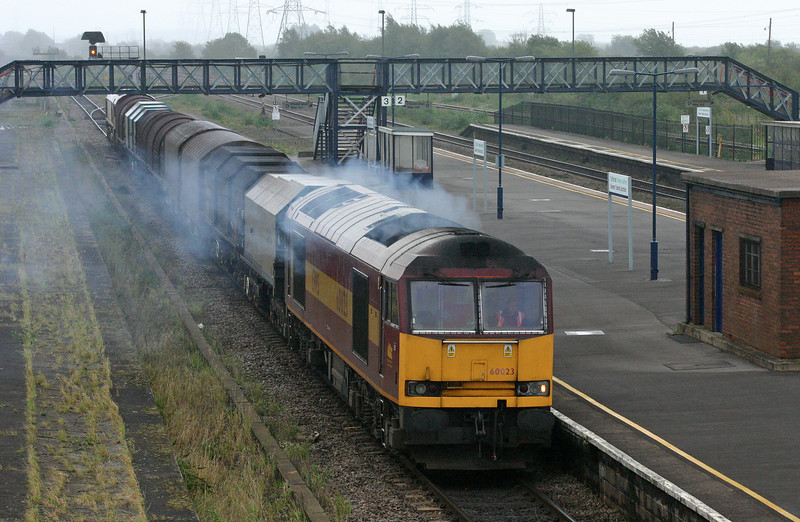 60023, down steel, departs Severn Tunnel Junction, 18-9-04. 66025 down light.