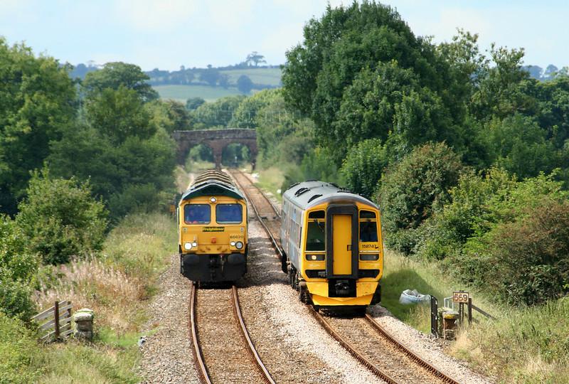 66620, 13.37 Meldon Quarry-Taunton Fairwater Yard, overtaken by 158747, 12.41 Barnstaple-Exmouth, Gunstone Mill, near Crediton, 29-8-07.