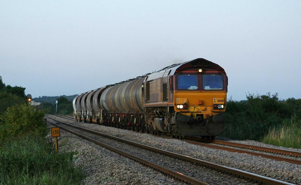 66158, 16.58 Bescot-Newport Alexandra Dock Junction, Alvington, near Lydney, 25-08-09.