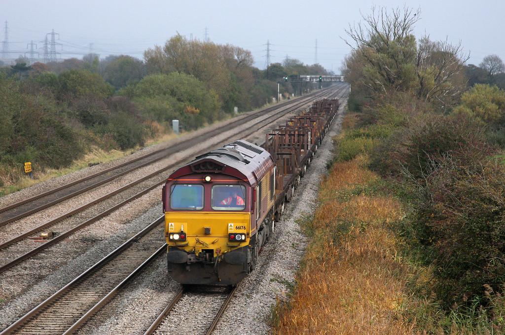 66176, 07.55 Llanwern-Cardiff Docks, Coedkernow, near Newport, 27-10-09.