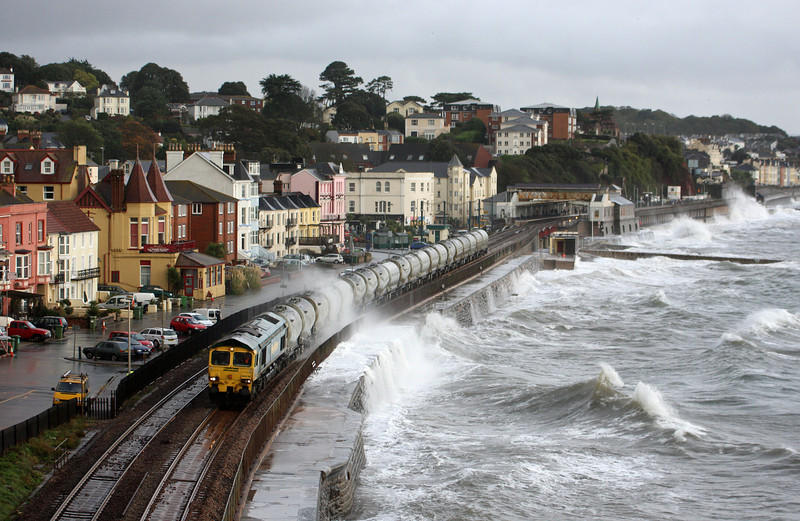 66518, 20.55 Earles Sidings-Moorswater, Dawlish, 22-10-09, in torrential rain and dodging the spray from heavy seas.