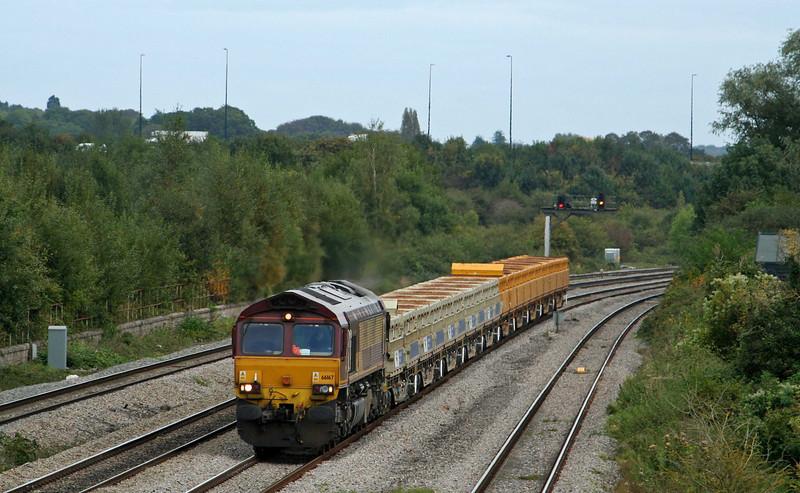 66167, 10.16 Westbury Yard-Newport Alexandra Dock Junction, Undy, near Magor, 17-9-09.