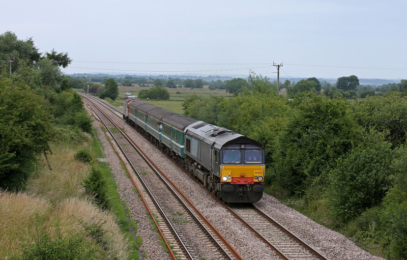 66402/57308, 14.00 Cardiff Central-Taunton, Banklands, near Durston, 28-6-10, delayed by lineside fire.