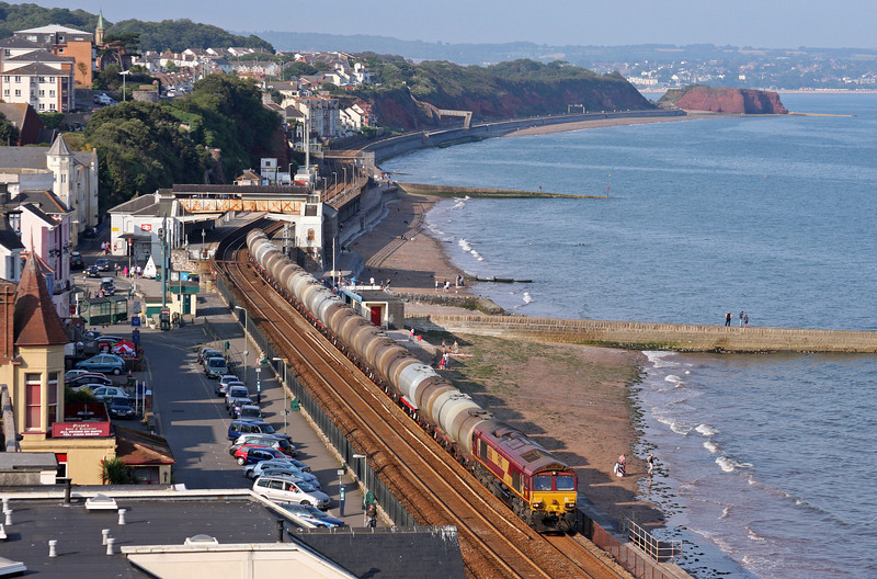 After being looped at Dawlish Warren for a passenger train to pass and checked by signals along the sea wall, Class 66 No 66116 accelerates past Dawlish with the Tuesdays-only 15.31 Bristol St Philip's Marsh-Plymouth Tavistock Junction Yard fuel tanks on August 2, 2011. The tanks were loaded at the Fawley refinery, on the Solent, and some will end up at Penzance.