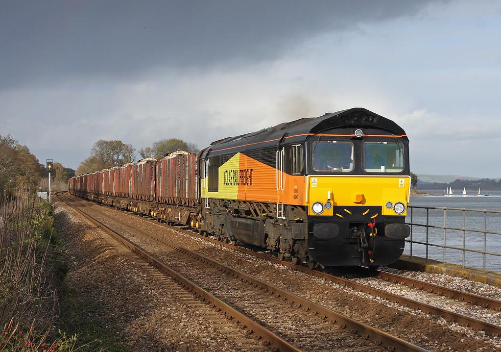 66847, 09.05 Gloucester New Yard-Heathfield ECC, Powderham, near Starcross, 5-12-11. First empties train for new Teigngrace-Chirk logs flow.