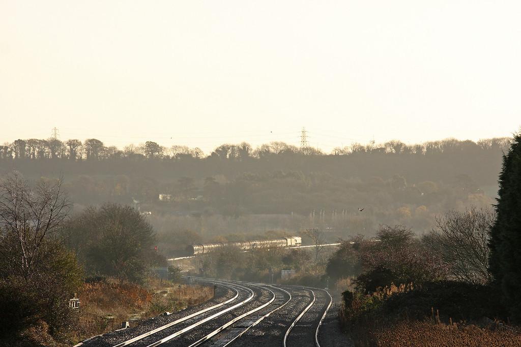 66142, 08.18 Llanwern-Swindon Steel Terminal, climbing towards Cattybrook, Bristol, 2-12-11.