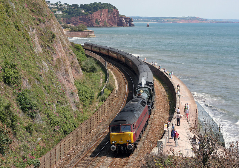 57601/6024, 06.05 Birmingham International-Plymouth, Teignmouth, 4-6-11. 6024 had set off lineside fires and been stopped by Network Rail.
