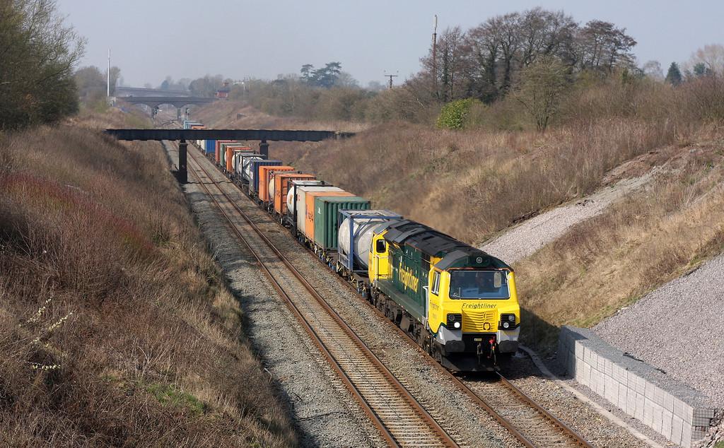 70003, 09.58 Cardiff Wentloog-Southampton Milbrook, departs Chipping Sodbury loop, 25-3-11.