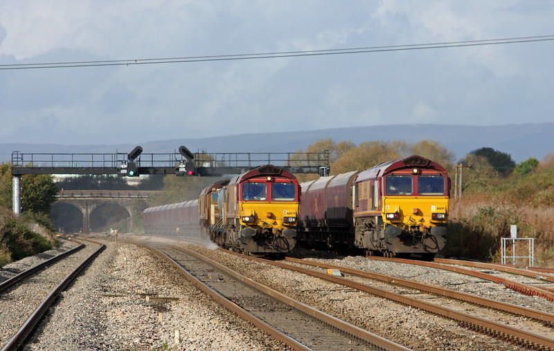66079/66143, 07.43 Moreton-on-Lugg-Weston-super-Mare RHTT, passing 66145, 08.29 Aberthaw Power Station-Portbury, Pilning, 1-11-11.