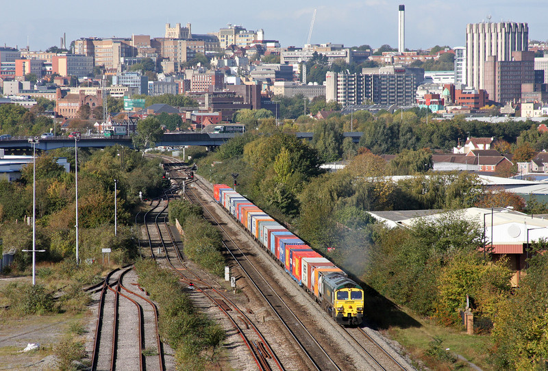 The impressive skyline of the centre of Bristol provides a stunning backdrop for Class 66 No 66503 as it accelerates away from Temple Meads, past St Philip's Marsh, and into the St Anne's area with a lengthy and well-loaded 11.00 Bristol Freightliner Terminal to Tilbury containers train on October 20, 2011.