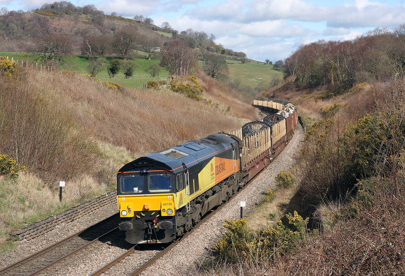 Class 66 No 66745 reaches the summit of Llanvihangel Bank, north of Abergavenny, with the 09.13 Chirk Kronospan-Teigngrace empty logs carriers on March 19, 2012. The train was heading straight to Devon from the Kronospan plant near Wrexham because the wagons had been used over the previous weekend. Normally, at that time, they headed south earlier and were then stabled at Gloucester New Yard over the weekend to await their next turn of duty.