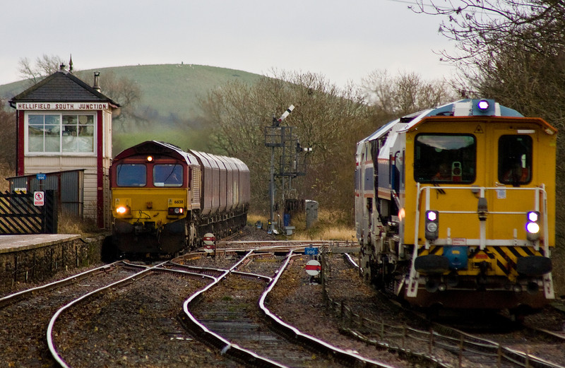 66138, 11.05 Drax Power Station-Hunterston, Hellifield, 21-11-13, passing stabled track maintenance machine DR77001.