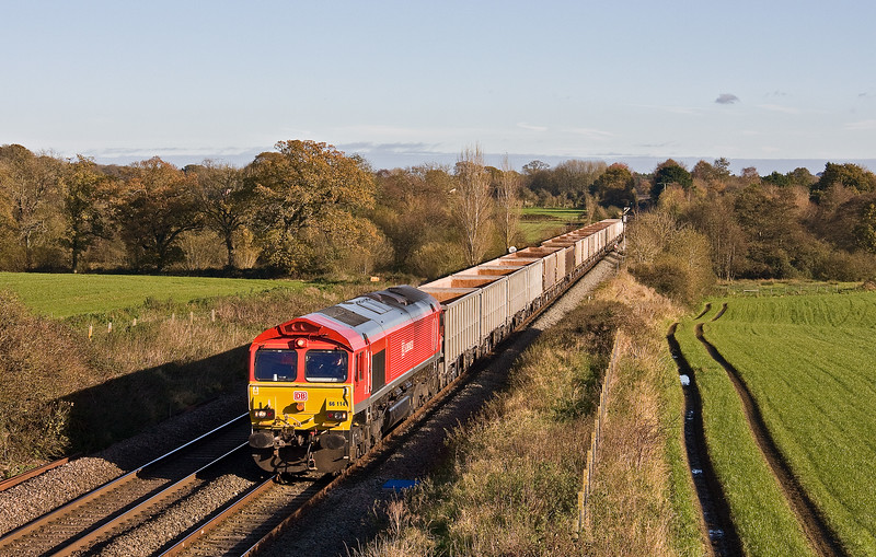 66114, 11.55 Oxford Banbury Road Sidings-Whatley Quarry, slowing to enter Woodborough Loops, near Pewsey, 8-11-17.