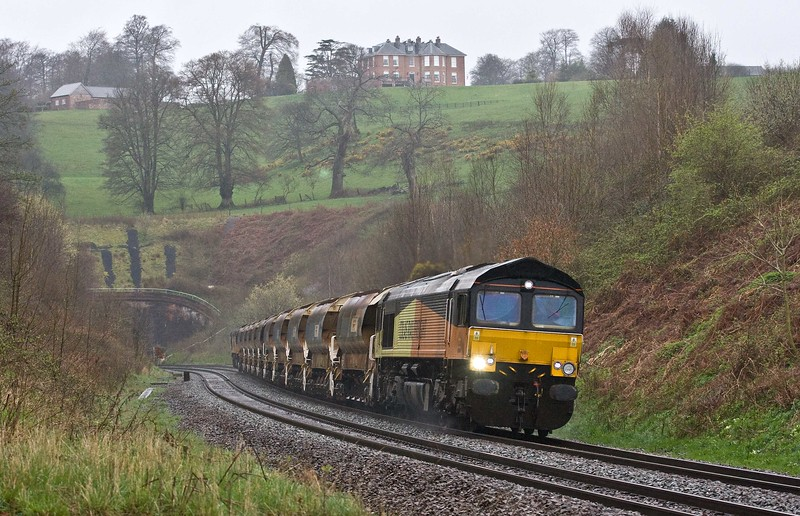 66848/66846, top'n'tail 09.00 Crediton-Westbury Yard, Marlands, near Wellington, 15-4-18. Late. From worksite on the Tarka Line.