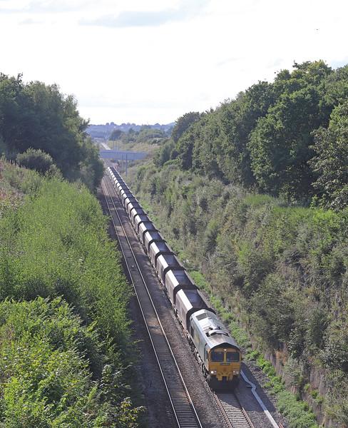 66547, 16.46 Newport East Usk Yard-Portbury Coal Terminal, Caldicot, 29-8-18, overtaking 66552, 16.26 Cardiff Wentloog-Tilbury International Rail Freight Terminal, looped.