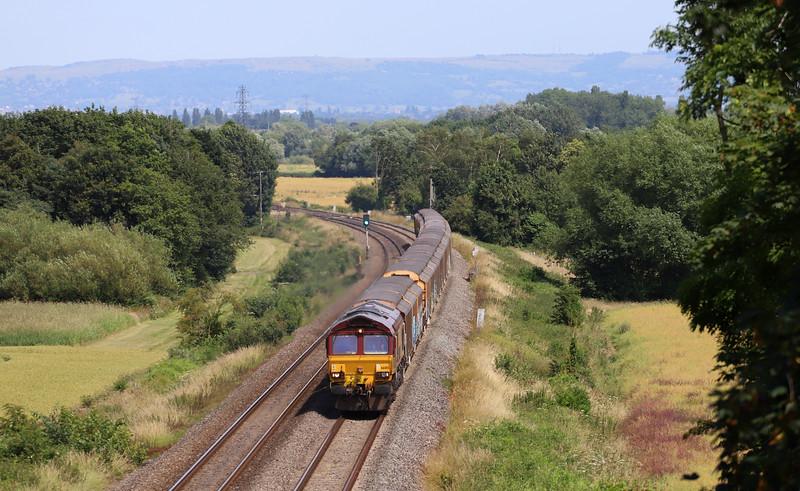 66015, 11.03 Burton-on-Trent-Cardiff Tidal Yard, Highnam, near Gloucester, 5-7-19. Overtaken by 4V44 Daventry-Cardiff Wentloog at Over.