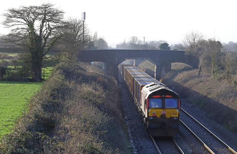 66107/66018, top-and-tail 09.33 Northolt-Severnside Sita, Edington, near Westbury, 15-1-20. Started journey 157min late.