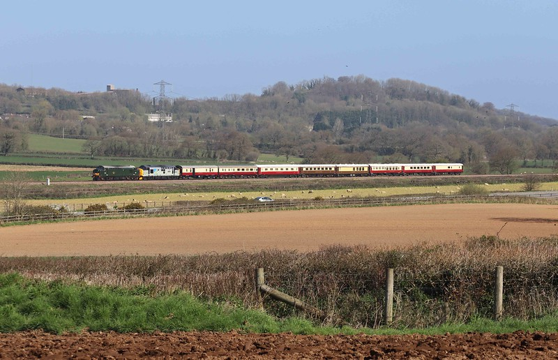 37667 (as D6851)/37688, 09.57 Bristol East Depot-Penzance, Pugham Crossing, near Burlescombe, 4-4-21. Third day of Locomotive Services Ltd six-day Easter private charter tour from Crewe to London Euston, via Carmarthen, Bristol, and Penzance.