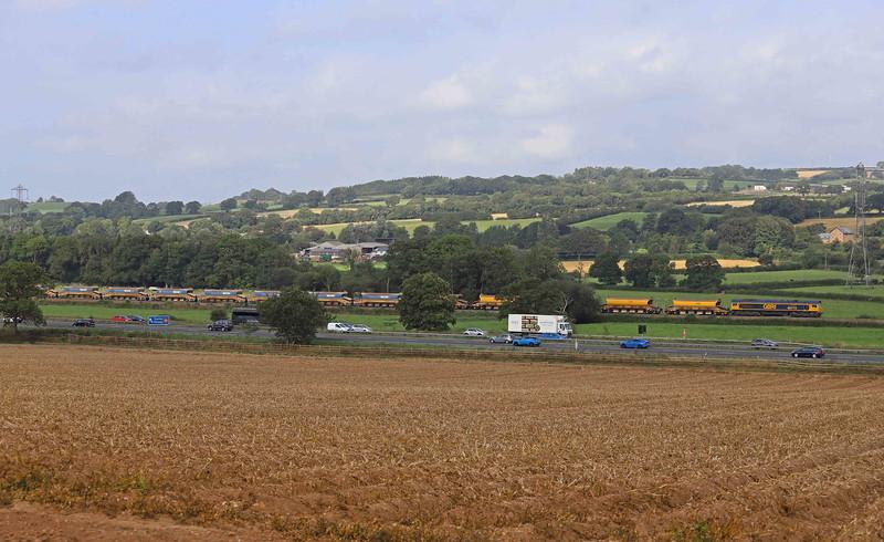 66715/66750, top-and-tail 09.00 Crediton-Westbury Yard, approaching Pugham Crossing, near Burlescombe, 3-9-21.