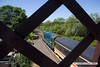 170618-003  Class 20 No 20205 is seen through the lattice work on the footbridge at Butterley station.