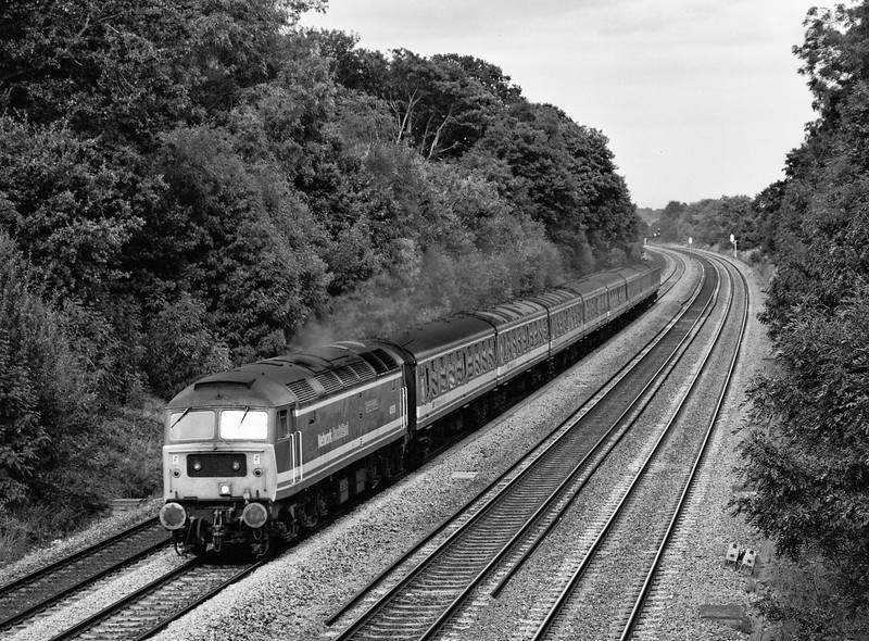 47579 heading into Sonning Cutting, with an unidentified NSE service, <br /> on 1st September 1990. Scanned Negative.