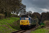 50027 passes the whistle board for Wanders Crossing, with the 10:20 Alton - Alresford, during the Diesel Gala on 23rd April 2016.