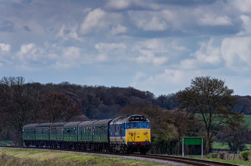 50027 passes the Wanders Crossing whistle board, with the 11:45 Alresford - Alton, <br /> during the Diesel Gala on 26th April 2013.