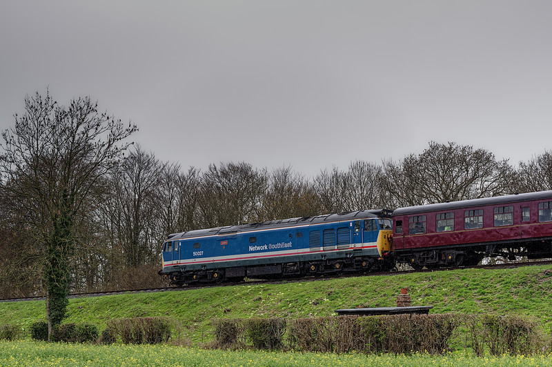 50027 passes the permanent way hut at Stable Lane, with the 11:00 Alton - Alresford, <br /> during the Diesel Gala on 22nd April 2016.