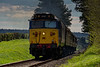 50027 powers away from Ropley, with the 15:15 Alresford - Alton, <br /> during the Diesel Gala on 23rd April 2016.