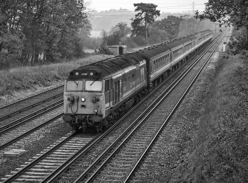 50027 at Ashmoor Lane, Old Basing, with 1V11, the 11:15 Waterloo - Exeter St Davids, <br /> on 18th November 1989. Scanned Negative.