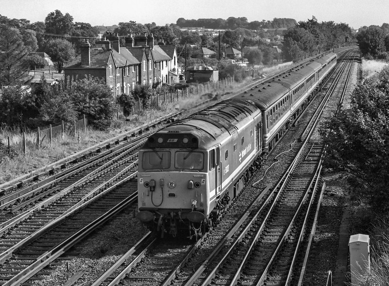 50027 at Worting Junction, with 1V09, the 09:15 Waterloo - Exeter St Davids, <br /> on 19th August 1989. Scanned Negative.