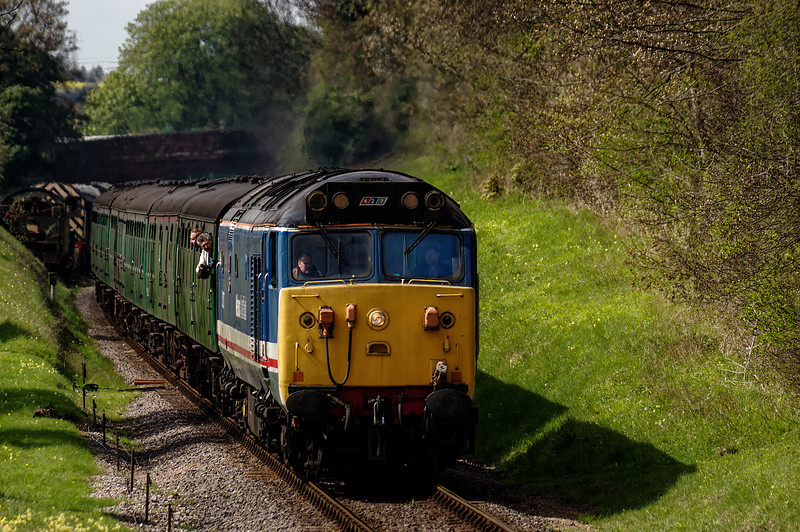 50027 climbs away from Ropley, with the 10:42 Alresford - Alton, private hire RAT, <br /> on 30th April 2016.