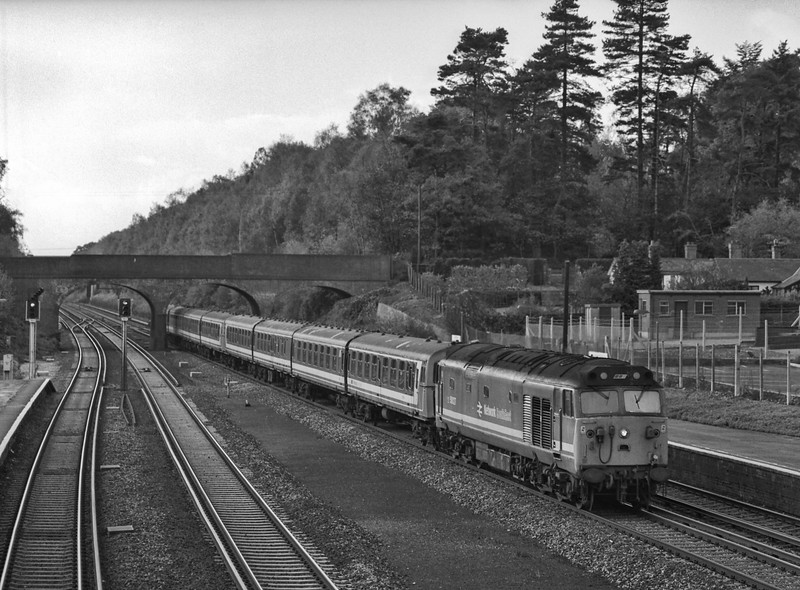 50027 plus 8-TC passing through Winchfield , with the 13:18 Salisbury - Waterloo, <br /> on 4th November 1989. Scanned Negative.