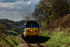 50027 passes the whistle board for Wanders Crossing, with the 11:15 Alresford - Alton, during the Diesel Gala on 23rd April 2016.